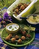 Meatballs skewered on rosemary with minted yoghurt dip