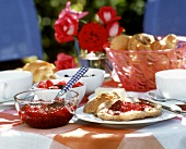 Breakfast table with rolls, raspberry jam etc.