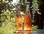 Two bottles of herb vinegar