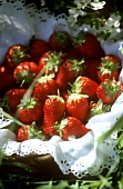 A basket of fresh strawberries in grass