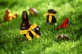 Chocolate Easter bunnies and chocolate eggs in grass