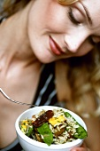 Blond woman with vegetable & date rice (1001 nights rice)