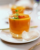 Carrot & orange soup with ginger, coriander & chili in glass