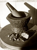 Pestle and mortar, spices in front