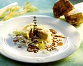 Celeriac and potato cakes on celeriac salad