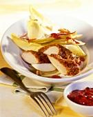 Chicory salad with rabbit fillet & cranberry vinaigrette