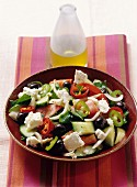 Greek salad with sheep's cheese served with sesame seed bread