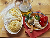 Various types of pasta, olive oil, sage, Parmesan & tomatoes
