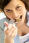 Woman eating oat muesli