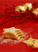 Star biscuits on red background