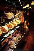 Various tapas in the counter display of a bar