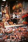 Sausage & ham specialities in counter display of butcher's shop