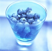 Blueberries in a blue glass
