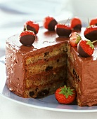 Four-layered chocolate gateau with fresh strawberries