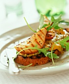 Stilton on toast with grilled pear and rocket
