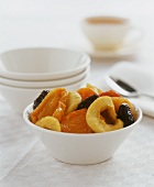 Dried fruit in a white pottery bowl