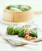 Cabbage leaves stuffed with shrimps and soya sprouts