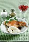 Rabbit leg in red wine sauce, semolina dumplings & red cabbage