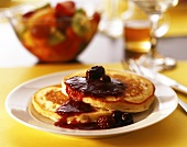 Two pancakes with berry and cherry sauce