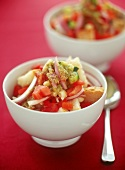 Spicy bread salad with beans, onions and strips of pepper