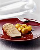 Carved loin of pork with kumquats