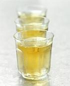 Three beakers of white wine
