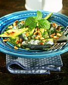 Marinated courgettes with sardine fillets and pine nuts