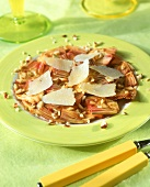 Artichoke carpaccio with Parmesan shavings and hazelnuts