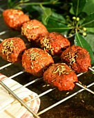 Barbecued kofte balls on skewer