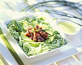 Green rice noodle salad with cucumber & pieces of raw tuna