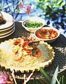 Couscous with seafood and tomato and chili sauce