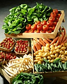 Fresh vegetables, lettuces and strawberries in wooden crates