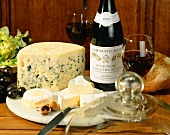 Cheese platter with French cheese and bottle of red wine