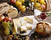 Cheese platter with French cheese, bread & glass of red wine