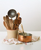 Old wooden and iron kitchen utensils, copper casserole