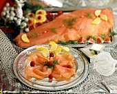 Smoked salmon decorated with raspberries and lemon slices