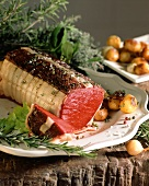 Roast beef roll with fresh herbs and potatoes