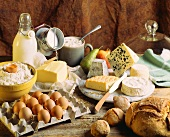 Still life with dairy products, eggs, bread, flour and fruit