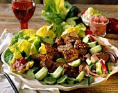 Colourful salad with beef, cucumber and salad leaves