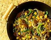 Asian wok dish with beef, peppers and pineapple