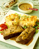 Rump steak with green pepper sauce and potato gratin