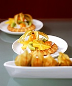 Tartlets with exotic fruit and slices of coconut