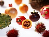 Various exotic fruits on a sheet of glass