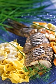 Pike with vegetables and ribbon pasta