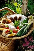 Barbecued mince kebabs in baguette, vegetables