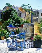 Blue table and wooden chairs on terrace of Greek outdoor café