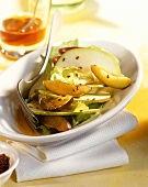 Endive with plums and apple slices