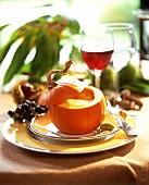Pumpkin soup served in a Golden Nugget pumpkin