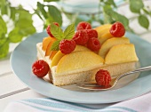 Vanilla sponge slice with peaches and raspberries
