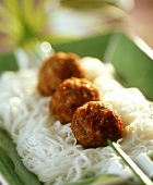Turkey balls on papyrus skewer on rice noodles